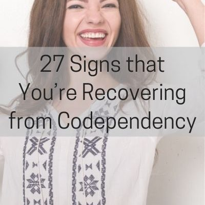 woman smiling, text: 27 signs that you're recovering from codependency